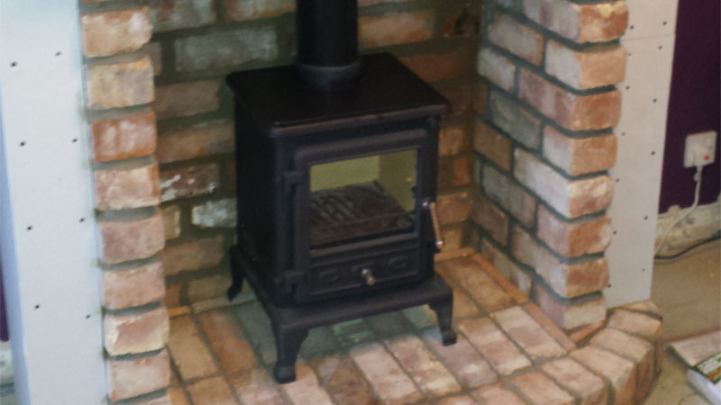 Firefox 5 multi fuel stove in false chimney breast